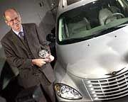 Chrysler-Chef Zetsche mit PT Cruiser: Der Sanierer hat offenbar einen Sanierungsfall geschaffen