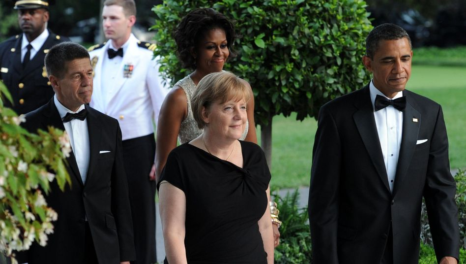 Angela Merkel and her husband Joachim Sauer during a 2011 visit with Barack and Michelle Obama at the White House.
