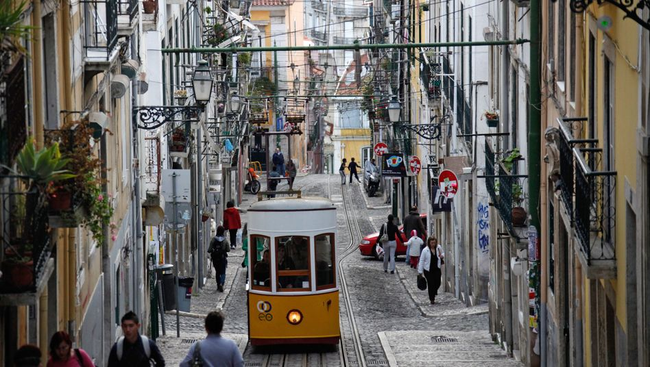 An uphill road in Lisbon: The decision by Moody's to downgrade Portugal's rating will further complicate the debt-strapped country's ability to raise fresh funds.