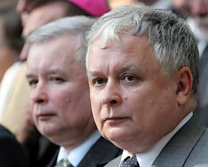 Prime Minster Jaroslaw (left) and President Lech Kaczynski want to revisit the past.