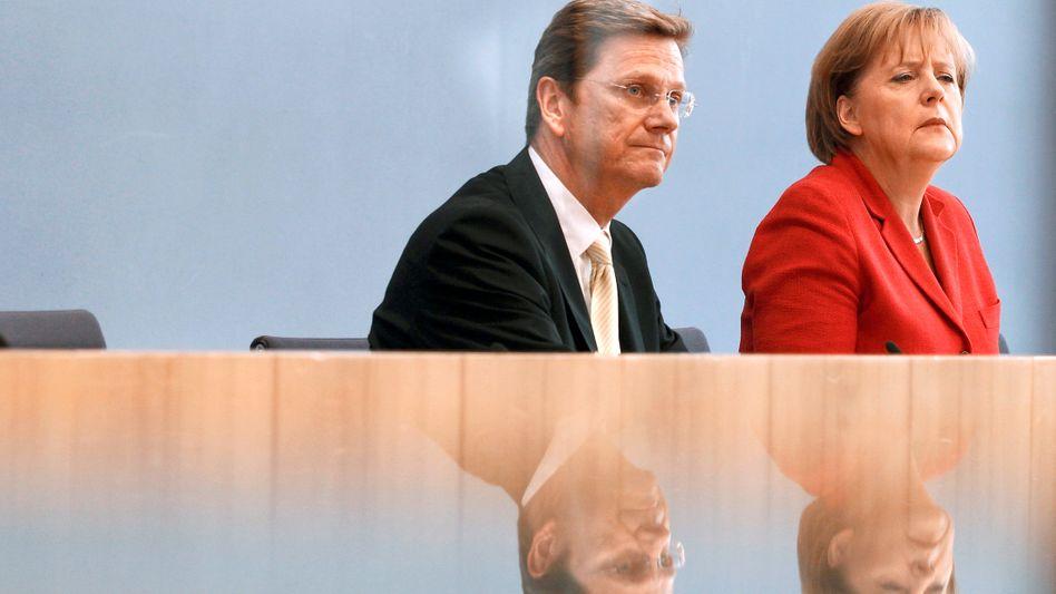 Bundeskanzlerin Merkel und Vizekanzler Westerwelle: Kein Geiz mit Superlativen