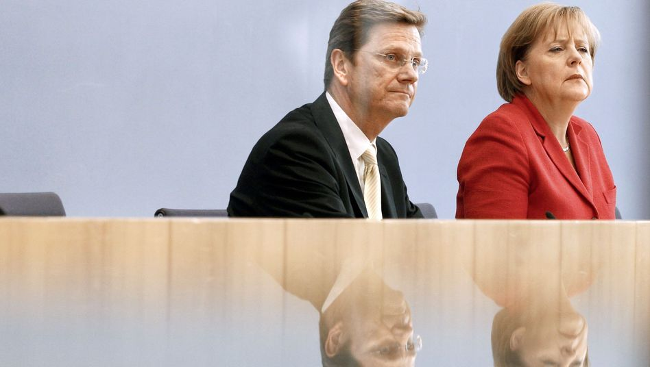German Foreign Minister Guido Westerwelle and Chancellor Angela Merkel: Germany's reputation has suffered as a result of the euro crisis.
