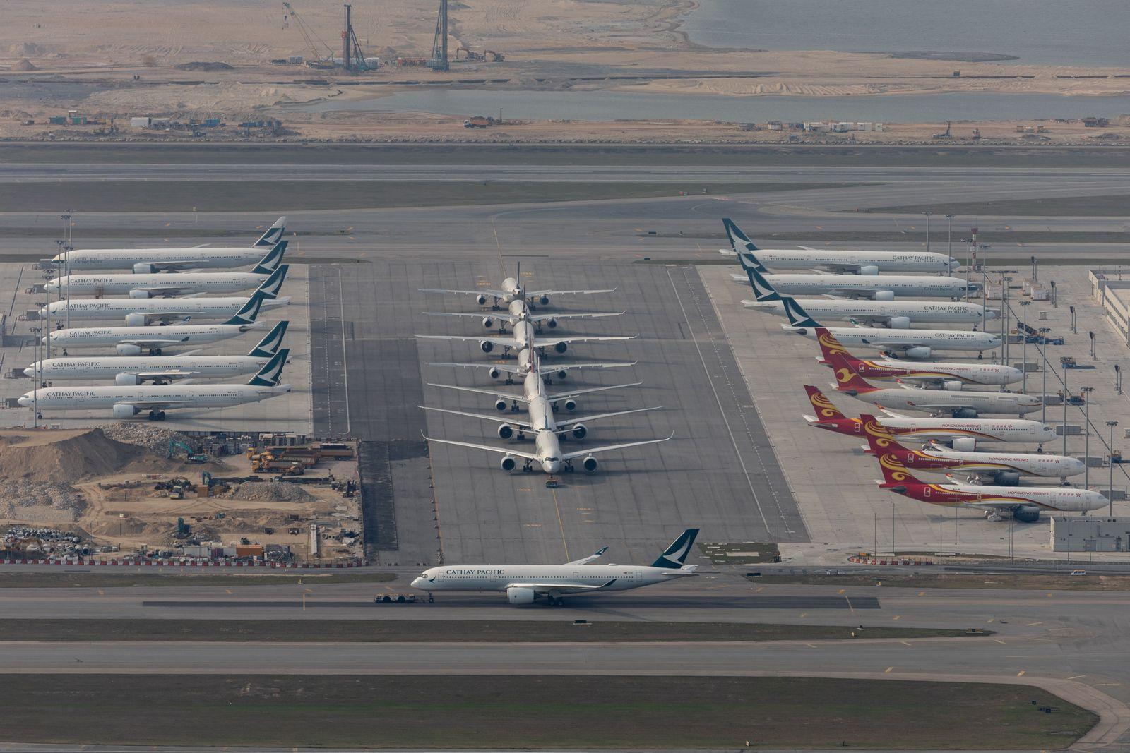 Cathay Pacific planes parked at Hong Kong International Airport, China - 15 Mar 2020