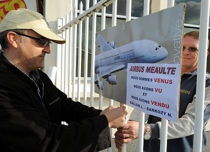 """An Airbus worker posts a protest poster at Airbus' plant in Méaulte, France, in April: """"We came, we saw, we sold. Gallois L./Sarkozy N."""" Frenchman Louis Gallois is Airbus' chief executive."""