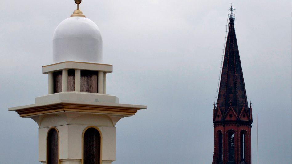 A minaret and a church tower in Berlin's Kreuzberg district.