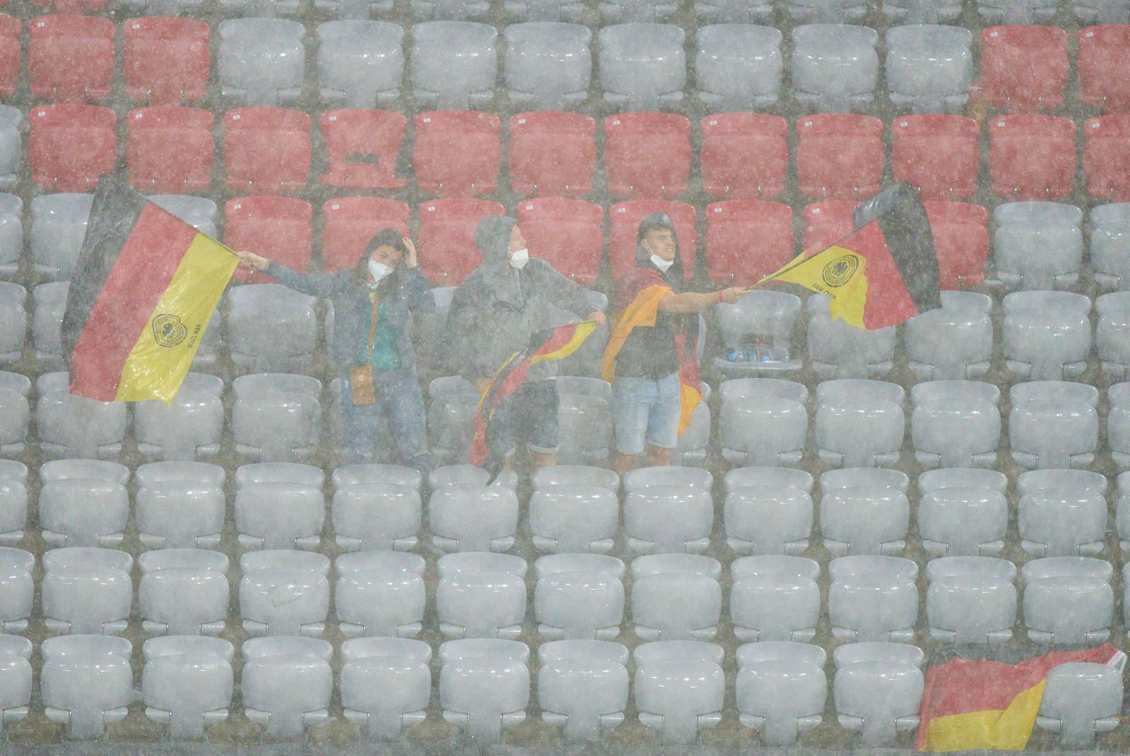 Heavy rain in the Allianz Arena , fans in the Group F match GERMANY - HUNGARY at the football UEFA European Championship