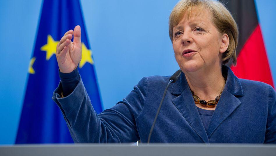 German Chancellor Angela Merkel was all smiles on Thursday morning.
