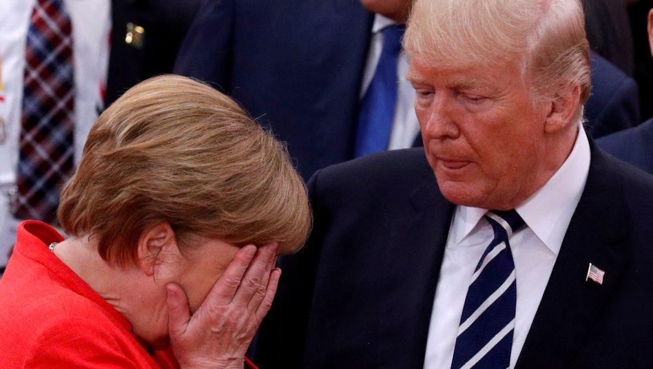 Beschädigte transatlantische Beziehungen: Angela Merkel neben Donald Trump (2017)