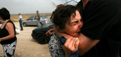 A distraught Georgian woman leaving her hometown of Gori following Russian shelling on Tuesday.