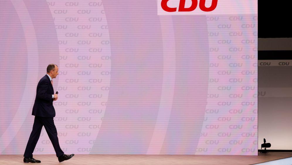 CDU-Politiker Merz auf dem Parteitag in Berlin im Januar: Vorsichtige Absetzbewegungen