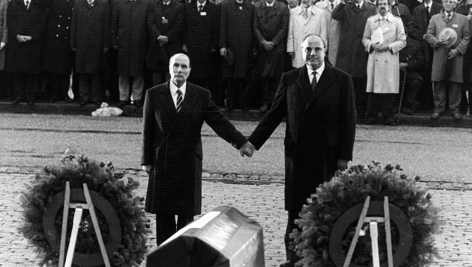 "Former French President Francois Mitterrand (left) and then-German Chancellor Helmut Kohl (right) in 1984: ""Passionately engaged politicians with their personal memories of the war"""