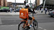Lieferdienst-Fahrer demonstrieren für bessere Bezahlung