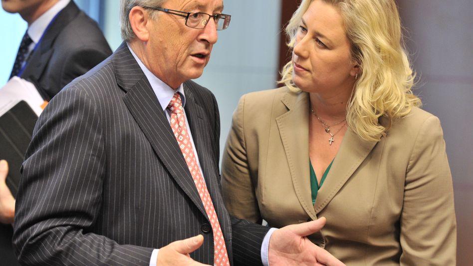 Eurogroup president Jean-Claude Juncker speaks with Finnish Finance Minister Jutta Urpilainen ahead of the Euro Group meeting in Brussels on Monday.