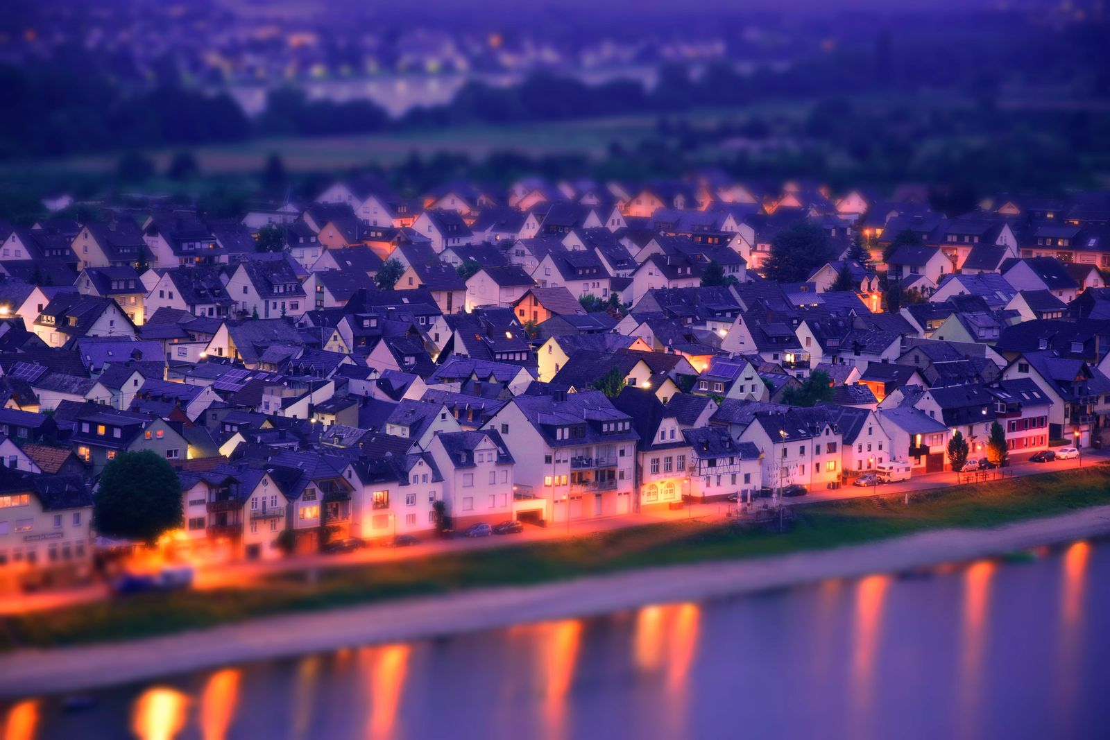 Aerial View Of Illuminated Houses In Town
