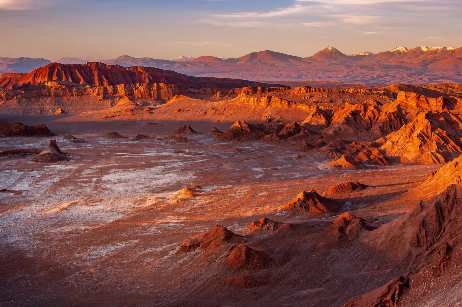 Golden sunset light casting strong shadow on the eerie moonscape at the Moon Valley, Atacama desert, Chile.