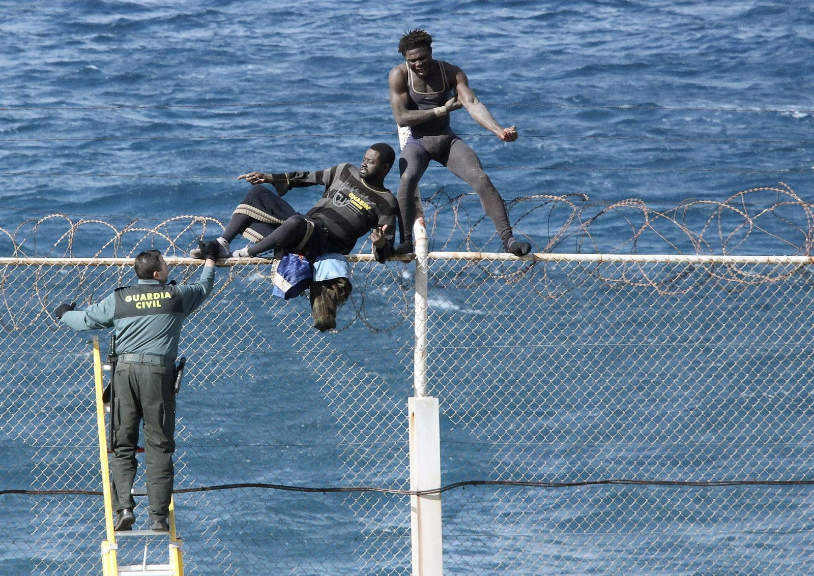 Immigrants try to cross Ceuta border fence
