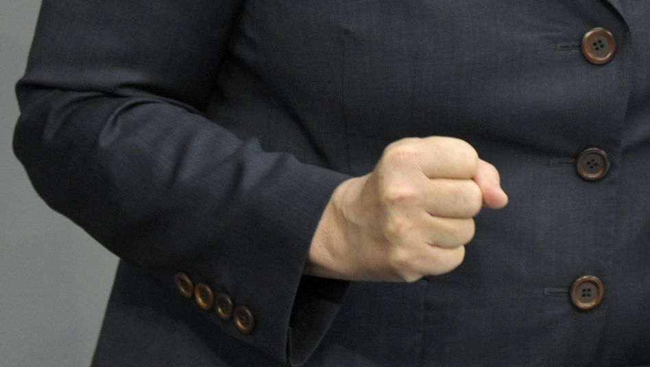 Chancellor Merkel clenchs her fist as she delivers a speech on the euro crisis to the German parliament on Thursday.