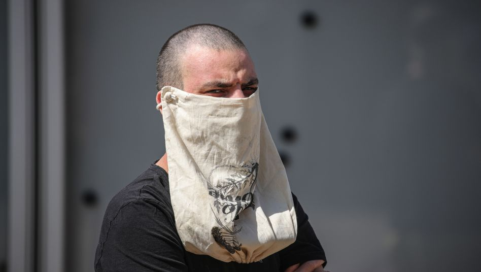 A man with an improvised mask