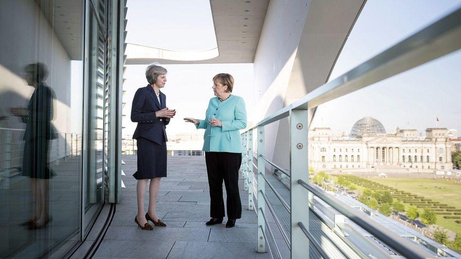 Britische Premierministerin May, Bundeskanzlerin Merkel: Ein schwieriges Stück Arbeit