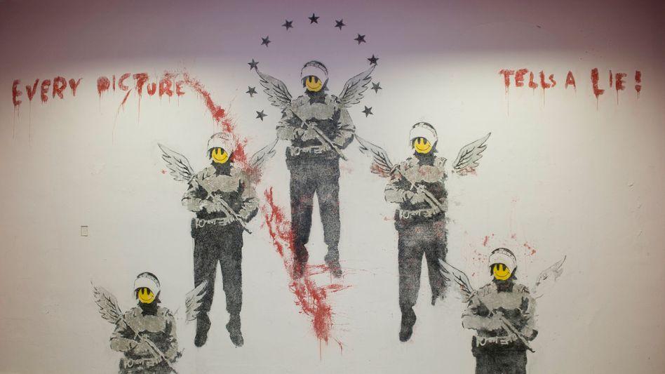 2003 bei einem Festival entstanden, war dieses Banksy-Bild von Farbschichten überdeckt