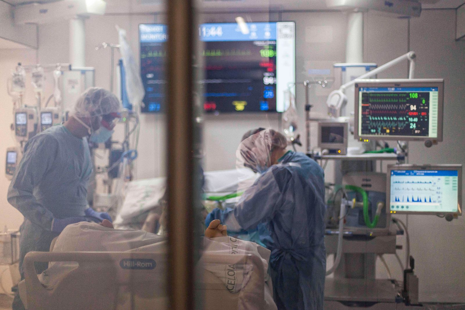April 29, 2020, Barcelona, Spain: Health workers wearing protective gear as a precaution assist a COVID19 patient in the