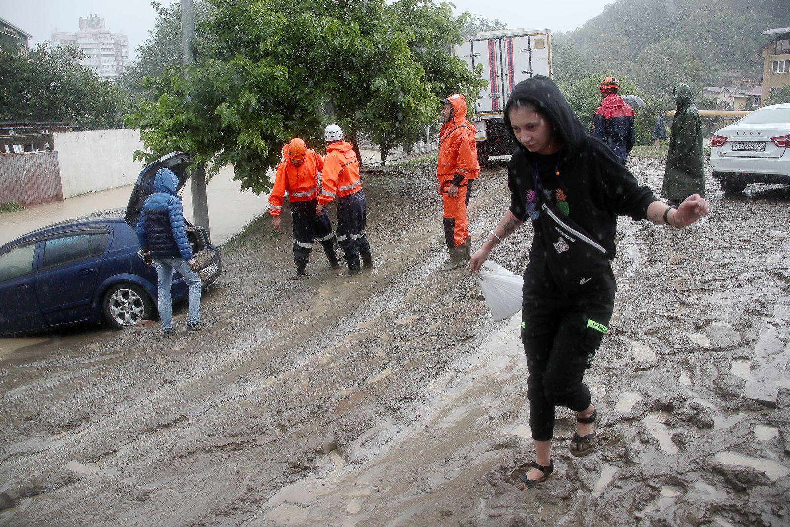 SOCHI, RUSSIA - JULY 5, 2021: Rescuers help residents of the flood-hit neighbourhood of Kudepsta, Khostinsky District. I