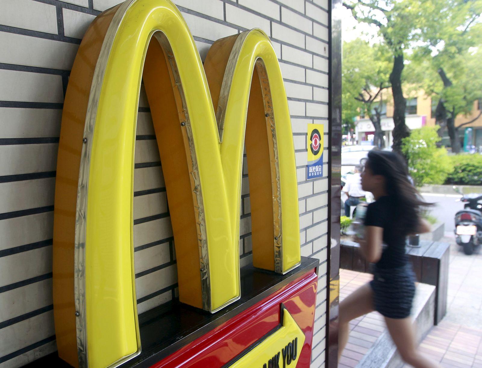 FILE PHOTO: A girl runs past a McDonald's store in Taipei