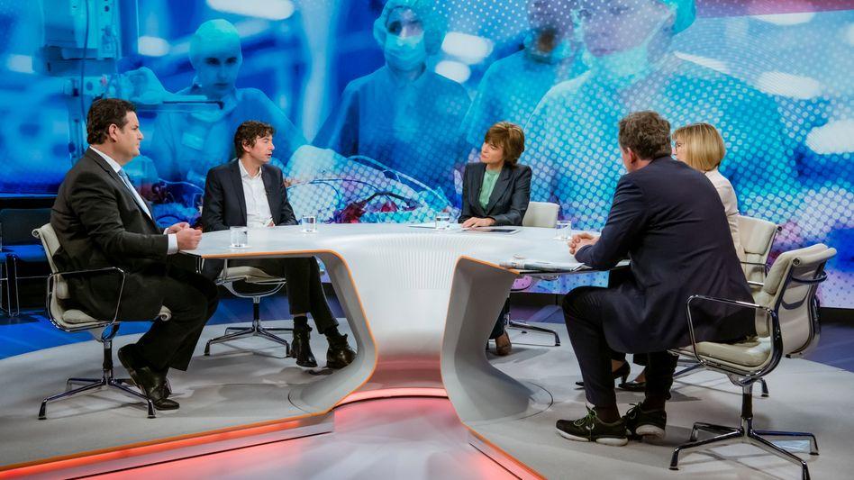 """Moderatorin Illner (M.) mit ihren Gästen: """"Was immer es kostet - gewinnen wir den Kampf gegen das Virus?"""""""