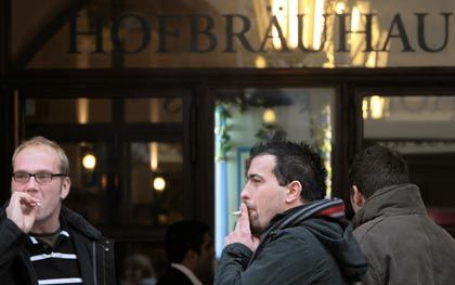 Out in the cold: Smokers have to go outside if they want to take a drag at Munich's world-famous Hofbräuhaus.