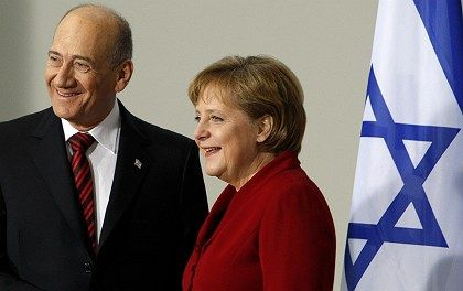 German Chancellor Angela Merkel meets with Israeli Prime Minister Ehud Olmert in the Chancellery in Berlin in this Feb. 2008 file photo. A new poll reveals that most Germans feel no historical responsibility toward Israel.