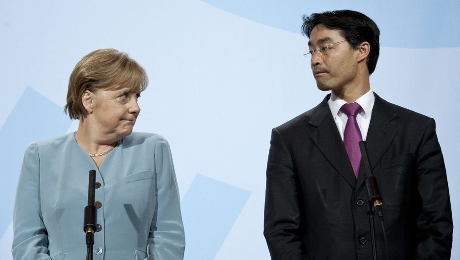 German Chancellor Angela Merkel may soon give a boost to her junior coalition partner, the Free Democrats led by Phillip Rösler (left).