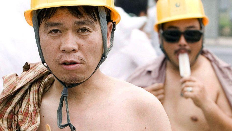 """Chinesische Wanderarbeiter in Peking: """"Ruinöse Dumpinglöhne sind die Folge"""""""