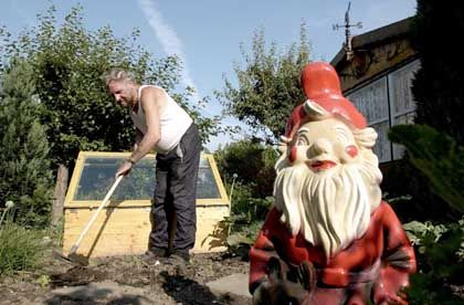A man, his garden gnome and a 9-page-thick law dictating just how his garden should be kept.