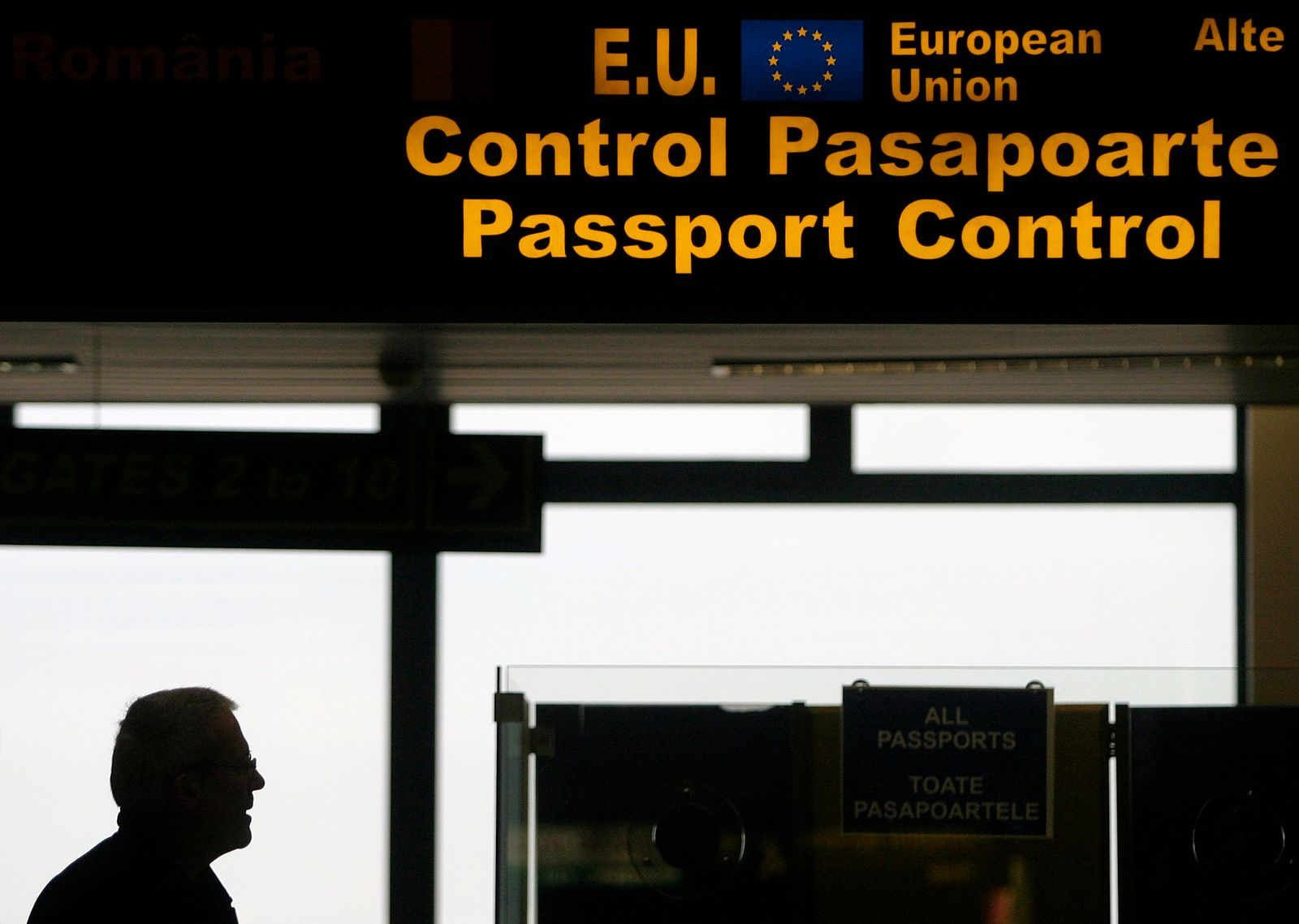 "Man walks in passport control area at Bucharest's ""Henri Coanda"" International Airport"