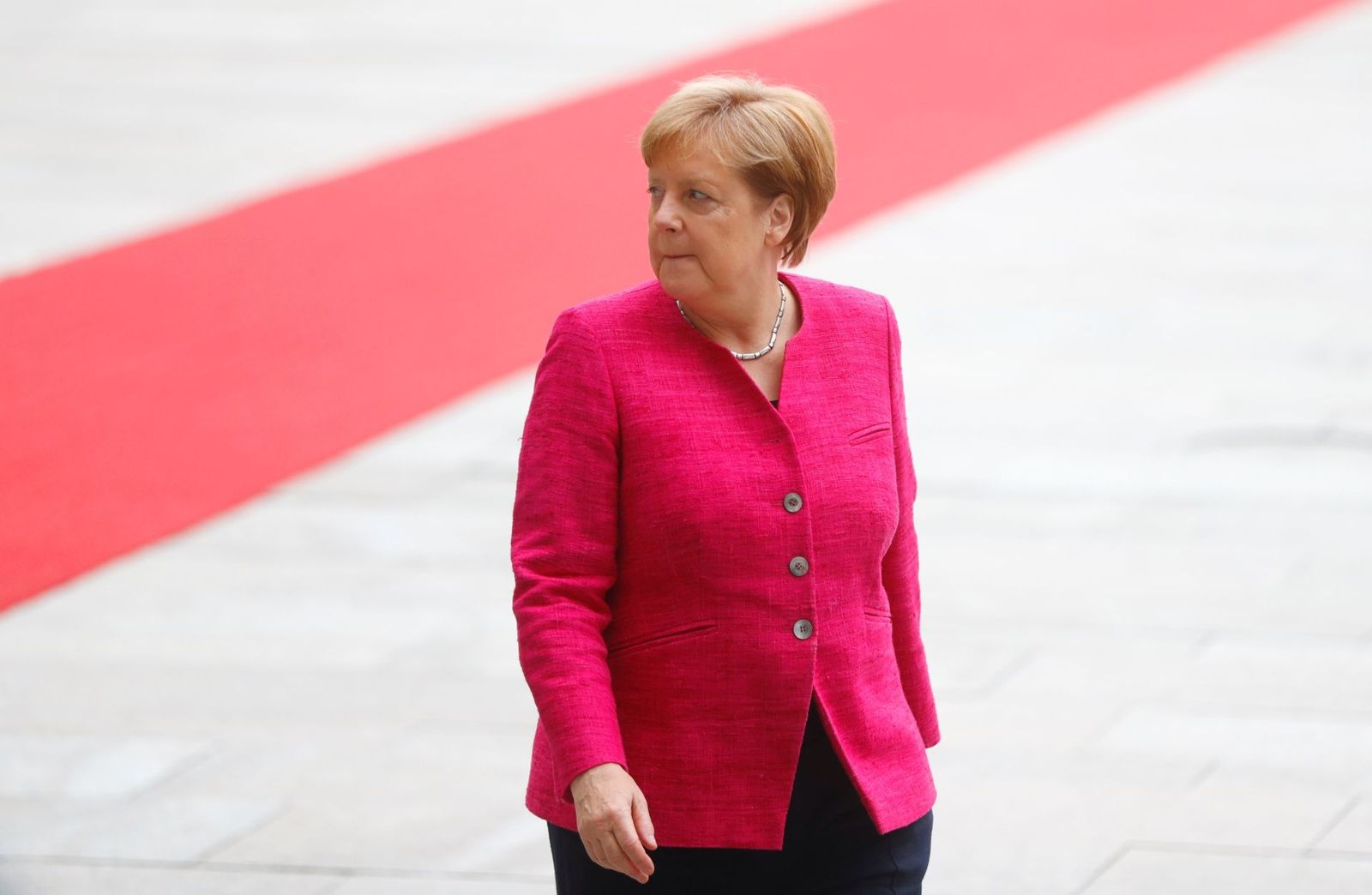 German Chancellor Angela Merkel looks on as she welcomes Spanish Prime Minister Pedro Sanchez at the chancellery in Berlin