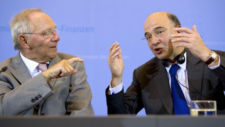 Finanzminister Schäuble, Kollege Moscovici: Ende des monatelangen Geschachers?