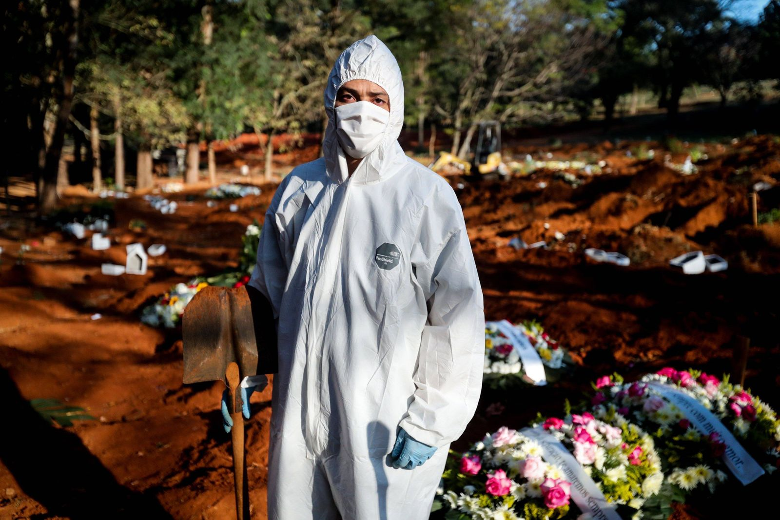 Gravediggers work in the Vila Formosa cemetery, in Sao Paulo, Brazil, 18 May 2020 (issued 19 May). Twelve hours and 62
