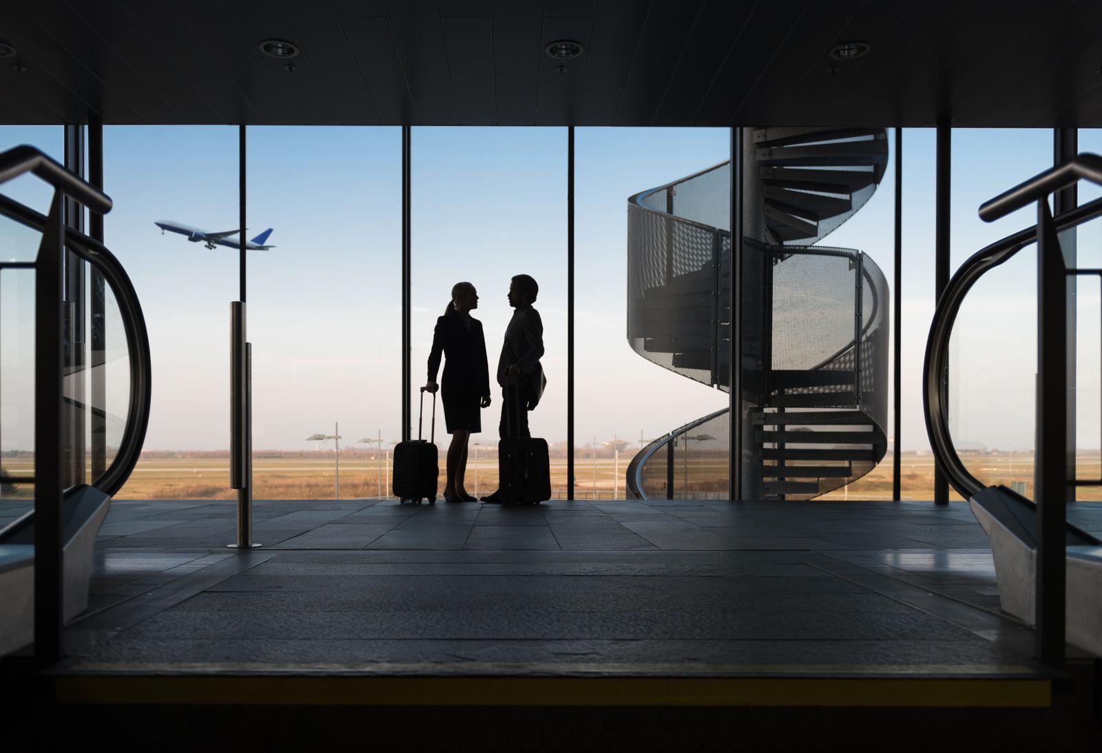 Silhouette Business Travellers At Airport