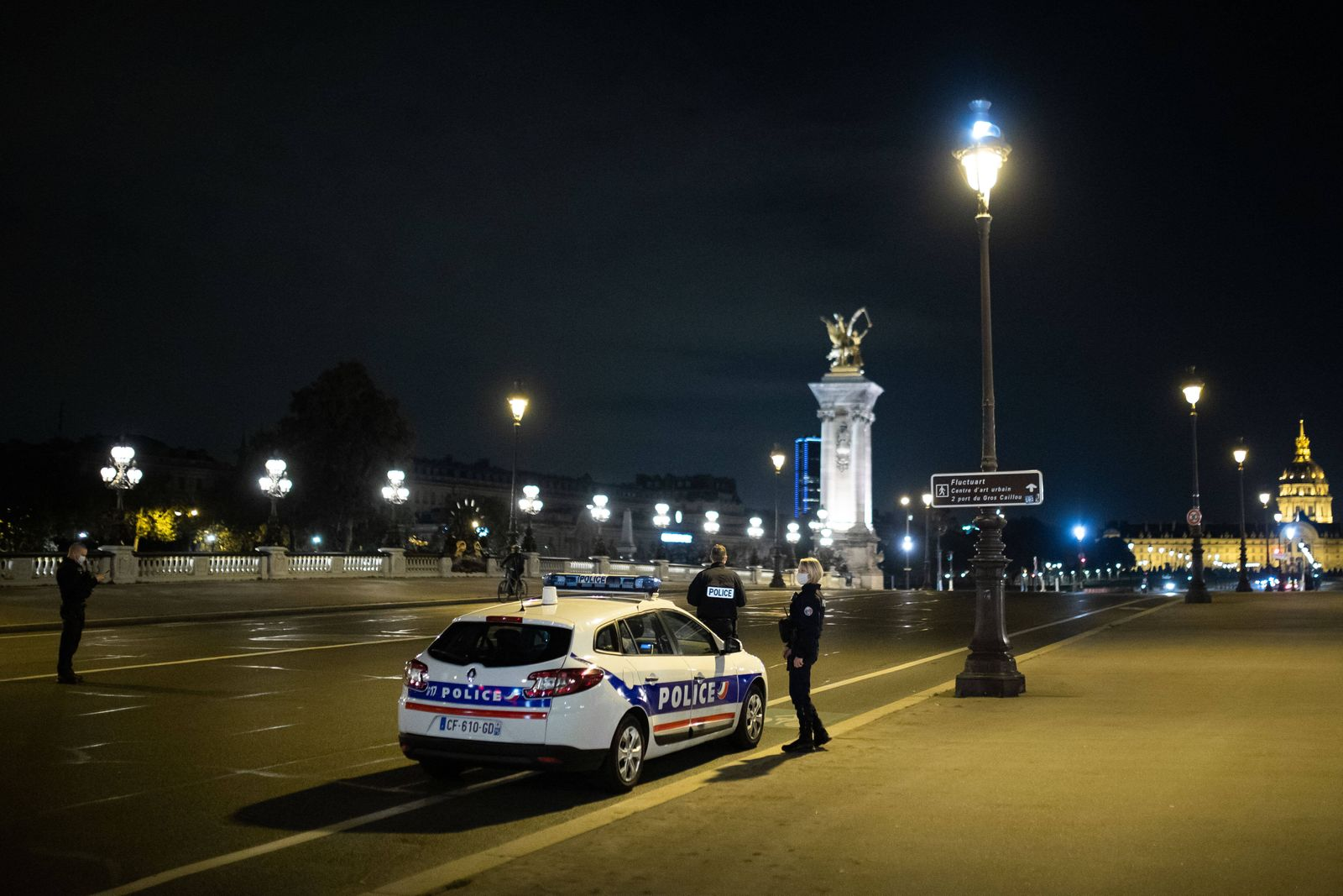 Paris, France, October 18, 2020 - Police officers in a car patrol at curfew time on the Pont Alexandre III. The French