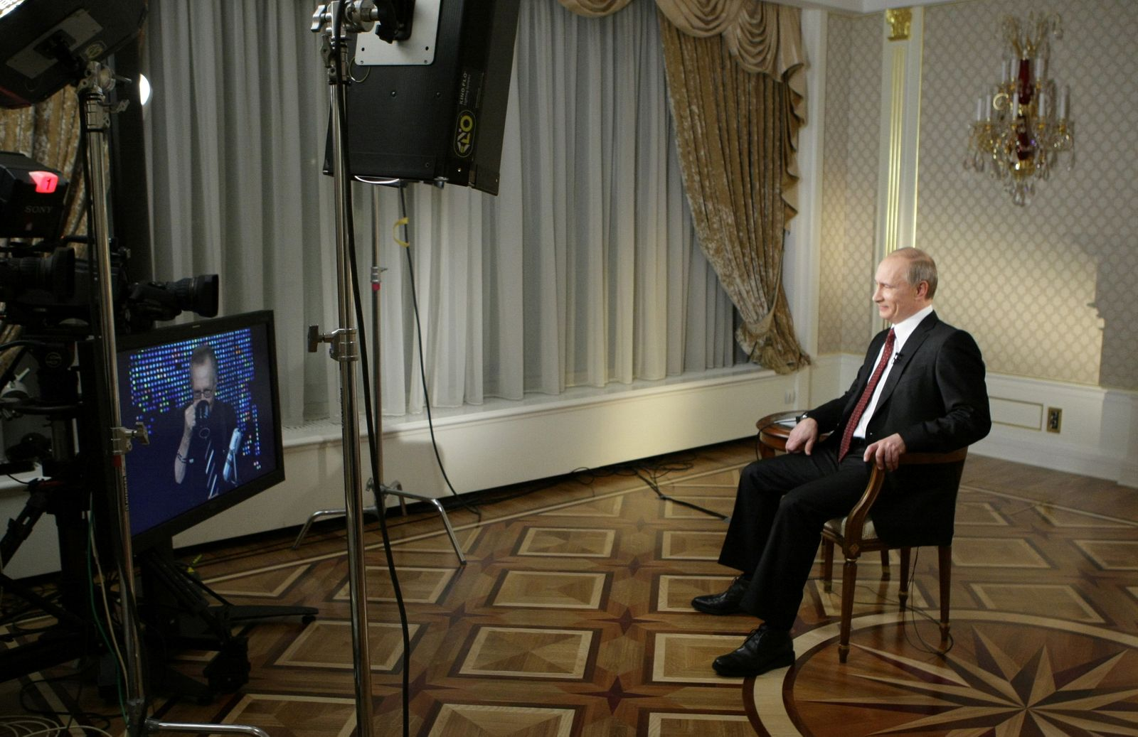 FILE PHOTO: Russia's Prime Minister Putin smiles during an interview with Larry King in Moscow