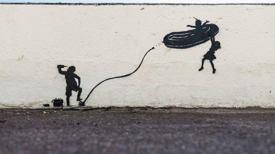 Dieses Motiv zeigt Banksy auf seiner Website – eine englische Gemeinde ließ es übermalen