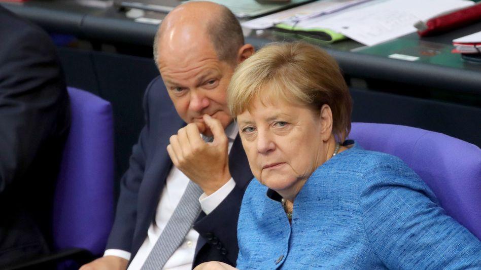 German Finance Minister Olaf Scholz with Chancellor Angela Merkel