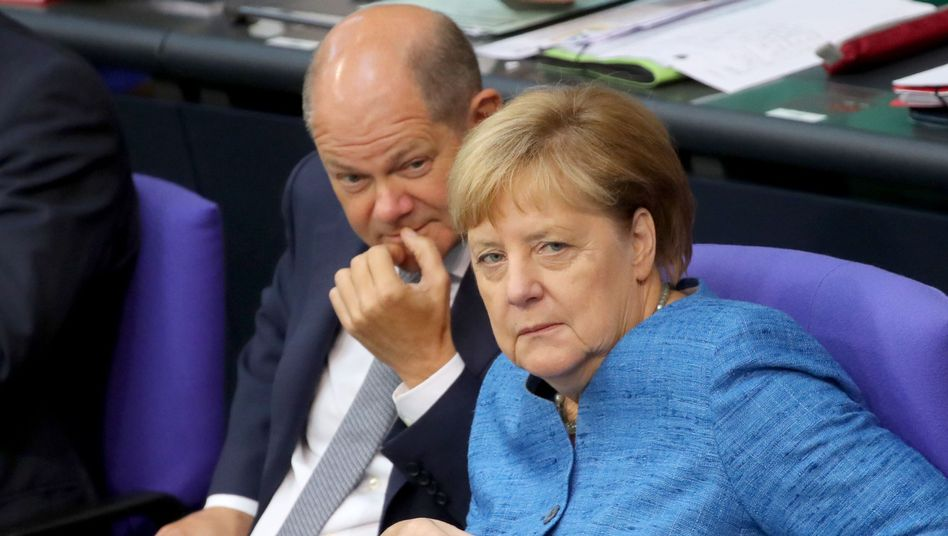 German Finance Minister Olaf Scholz with Chancellor Angela Merkel