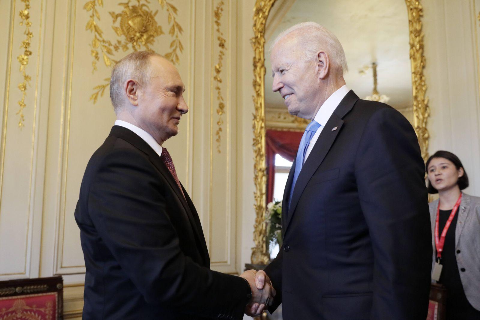 GENEVA, SWITZERLAND JUNE 16, 2021: Russia s President Vladimir Putin (L) and US President Joe Biden shake hands as th