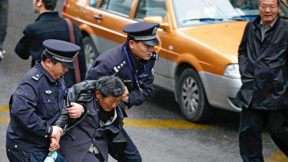 Festnahme eines Demonstranten in Shanghai