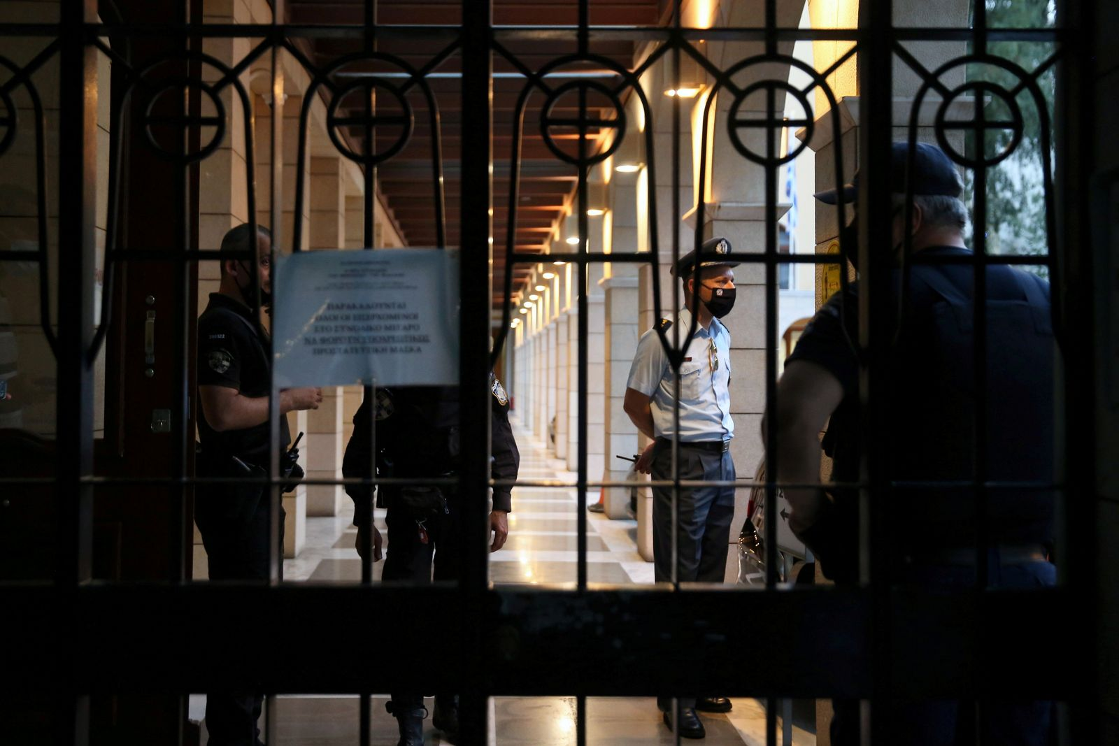 Police officers are seen at the entrance of Petraki Monastery after a priest attacked with acid against seven bishops, in Athens