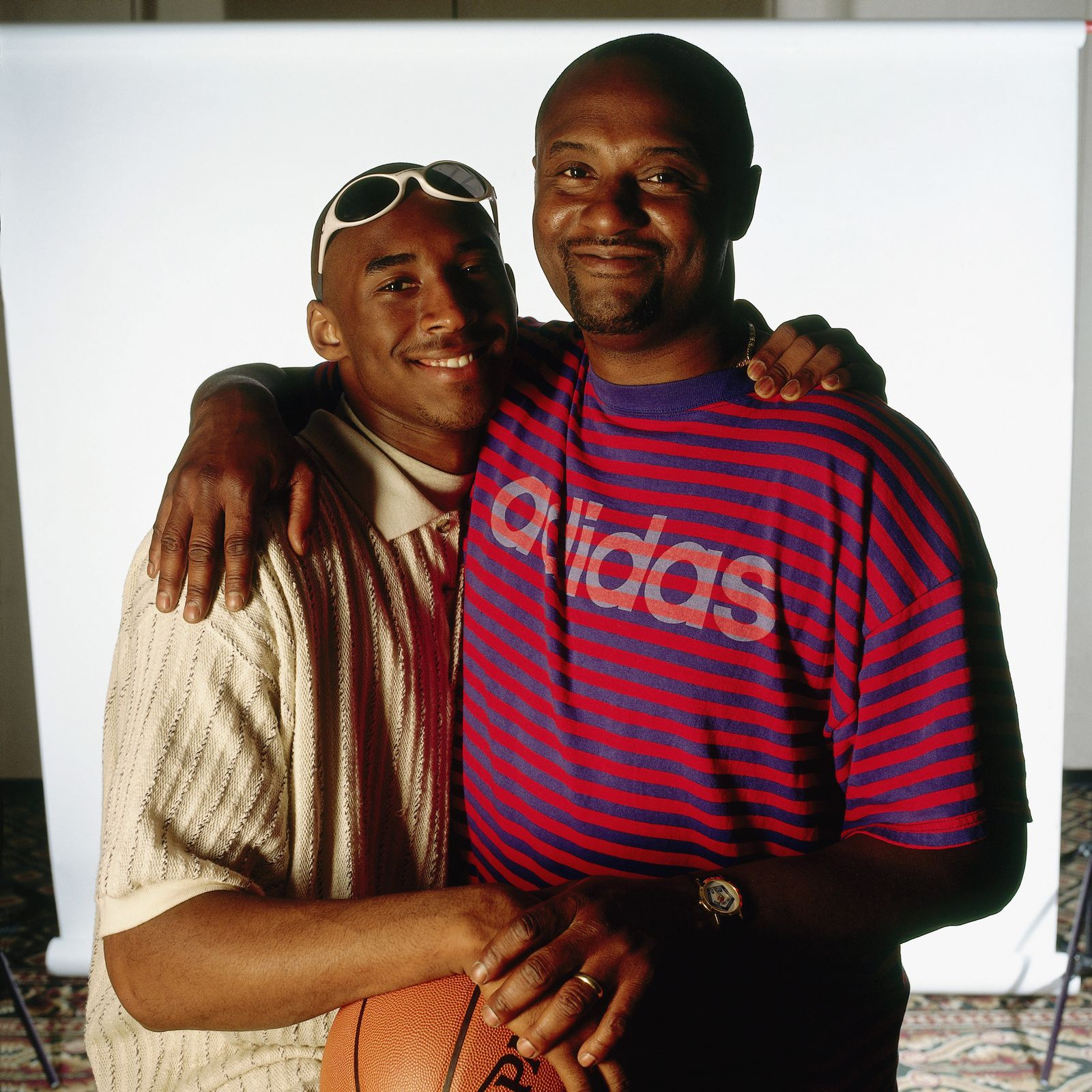 Bryant and father pose for a portrait