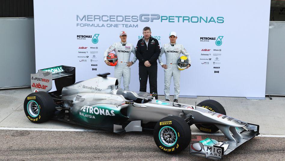 Mercedes-Piloten Schumacher (l.) und Rosberg (r.): Übernahme der fehlenden 24,9 Prozent