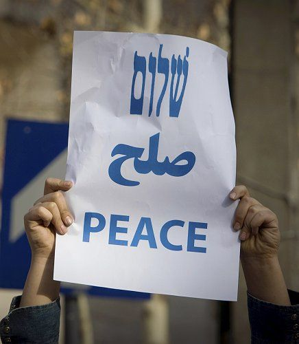 An Iranian Jewish school boy holds a sign in Tehran.