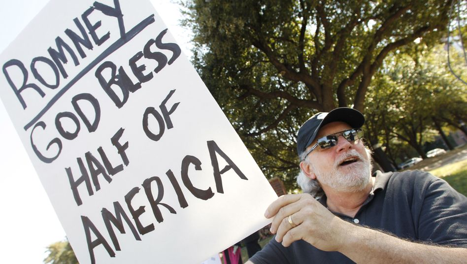 An anti-Romney protest outside a Texas fundraiser on Tuesday.
